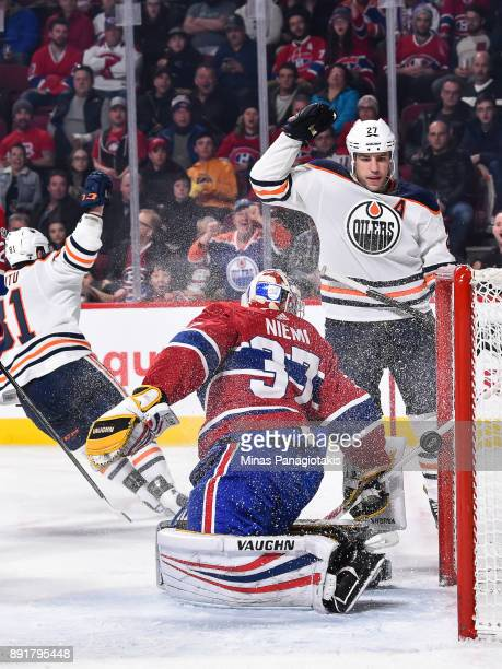 Milan Lucic of the Edmonton Oilers reacts after the puck enters the net of goaltender Antti Niemi of the Montreal Canadiens during the NHL game at...