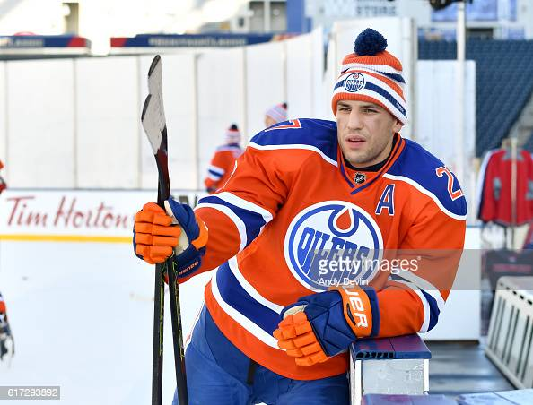 Milan Lucic of the Edmonton Oilers takes a break during practice in advance of the 2016 Tim Hortons NHL Heritage Classic game at Investors Group...
