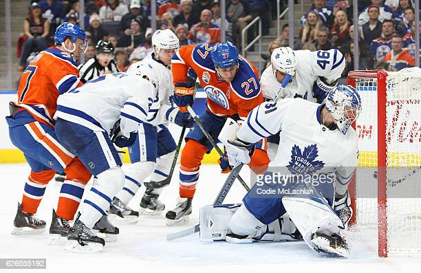Milan Lucic of the Edmonton Oilers tries to put the puck behind goalie Frederik Andersen of the Toronto Maple Leafs on November 29 2016 at Rogers...