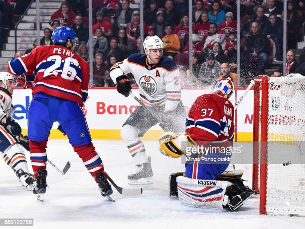 Milan Lucic of the Edmonton Oilers watches as the puck enters the net of goaltender Antti Niemi of the Montreal Canadiens during the NHL game at the...