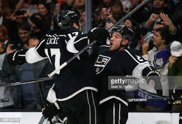 Milan Lucic of the Los Angeles Kings and Alec Martinez of the Los Angeles Kings react to an overtime goal to beat the Chicago Blackhawks 32 at...