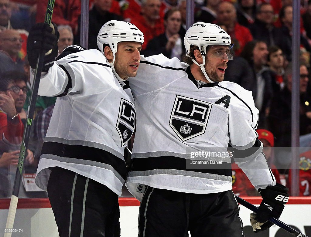 Milan Lucic #17 of the Los Angeles Kings (L) gets a hug from Anze Kopitar #11 after scoring a first period goal against the Chicago Blackhawks at the United Center on March 14, 2016 in Chicago, Illinois.