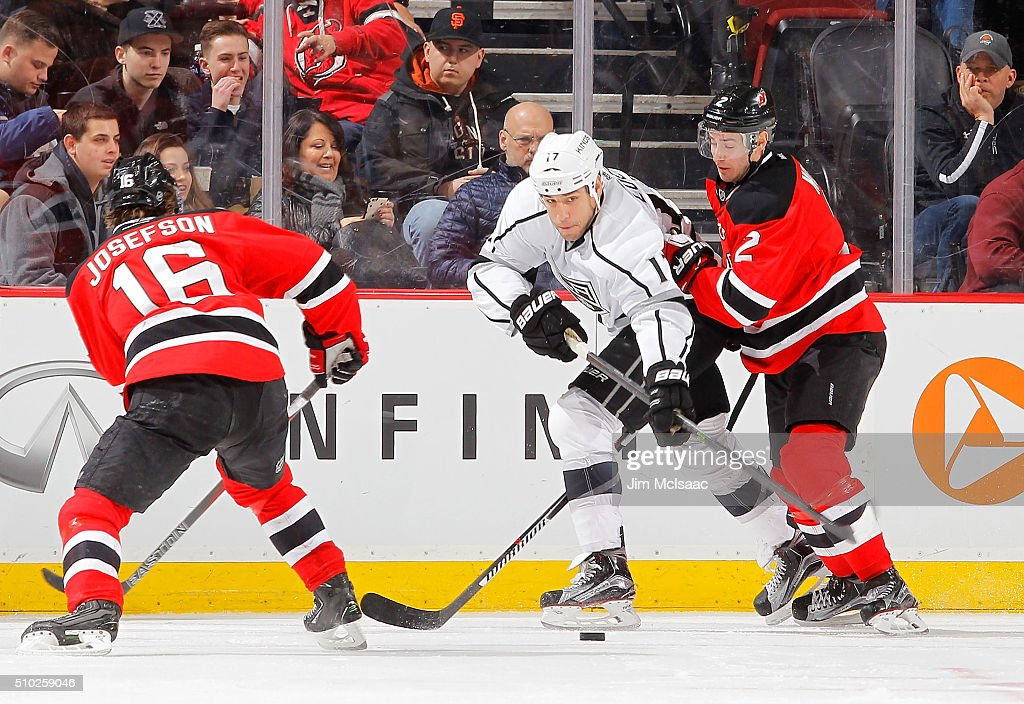 <a gi-track='captionPersonalityLinkClicked' href=/galleries/search?phrase=Milan+Lucic&family=editorial&specificpeople=537957 ng-click='$event.stopPropagation()'>Milan Lucic</a> #17 of the Los Angeles Kings plays the puck in the second period against <a gi-track='captionPersonalityLinkClicked' href=/galleries/search?phrase=John+Moore+-+Ice+Hockey+Player&family=editorial&specificpeople=5948842 ng-click='$event.stopPropagation()'>John Moore</a> #2 and <a gi-track='captionPersonalityLinkClicked' href=/galleries/search?phrase=Jacob+Josefson&family=editorial&specificpeople=5648065 ng-click='$event.stopPropagation()'>Jacob Josefson</a> #16 of the New Jersey Devils at the Prudential Center on February 14, 2016 in Newark, New Jersey.