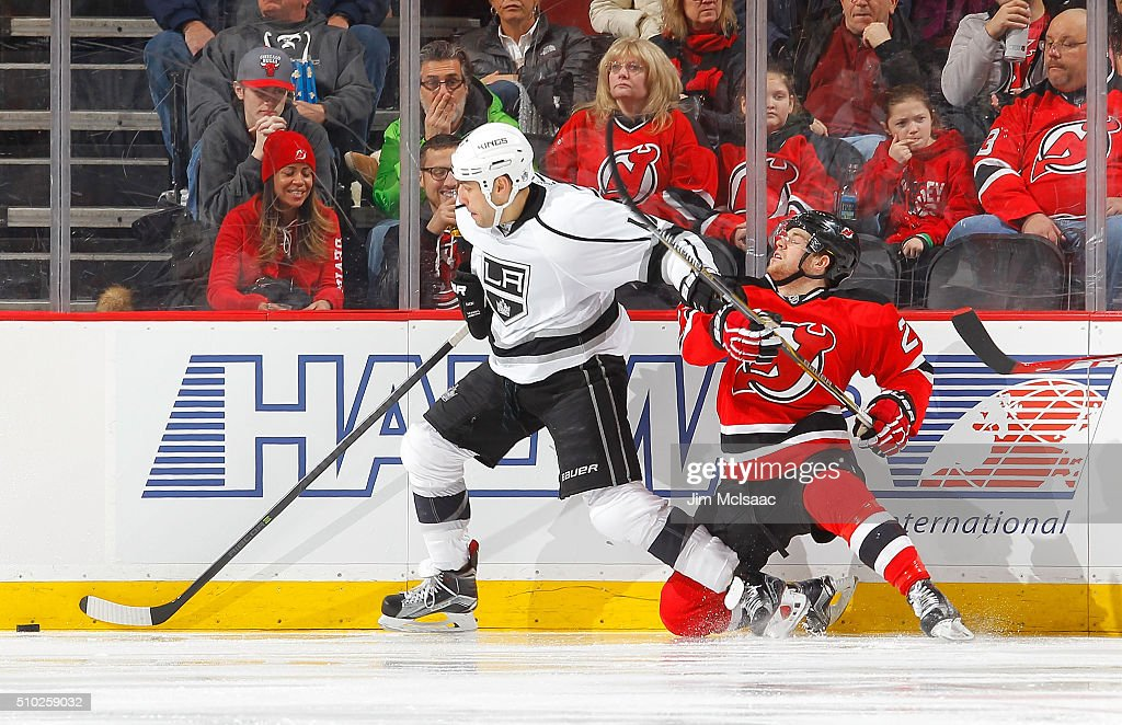 <a gi-track='captionPersonalityLinkClicked' href=/galleries/search?phrase=Milan+Lucic&family=editorial&specificpeople=537957 ng-click='$event.stopPropagation()'>Milan Lucic</a> #17 of the Los Angeles Kings skates with the puck past Bobby Farnham #23 of the New Jersey Devils at the Prudential Center on February 14, 2016 in Newark, New Jersey.