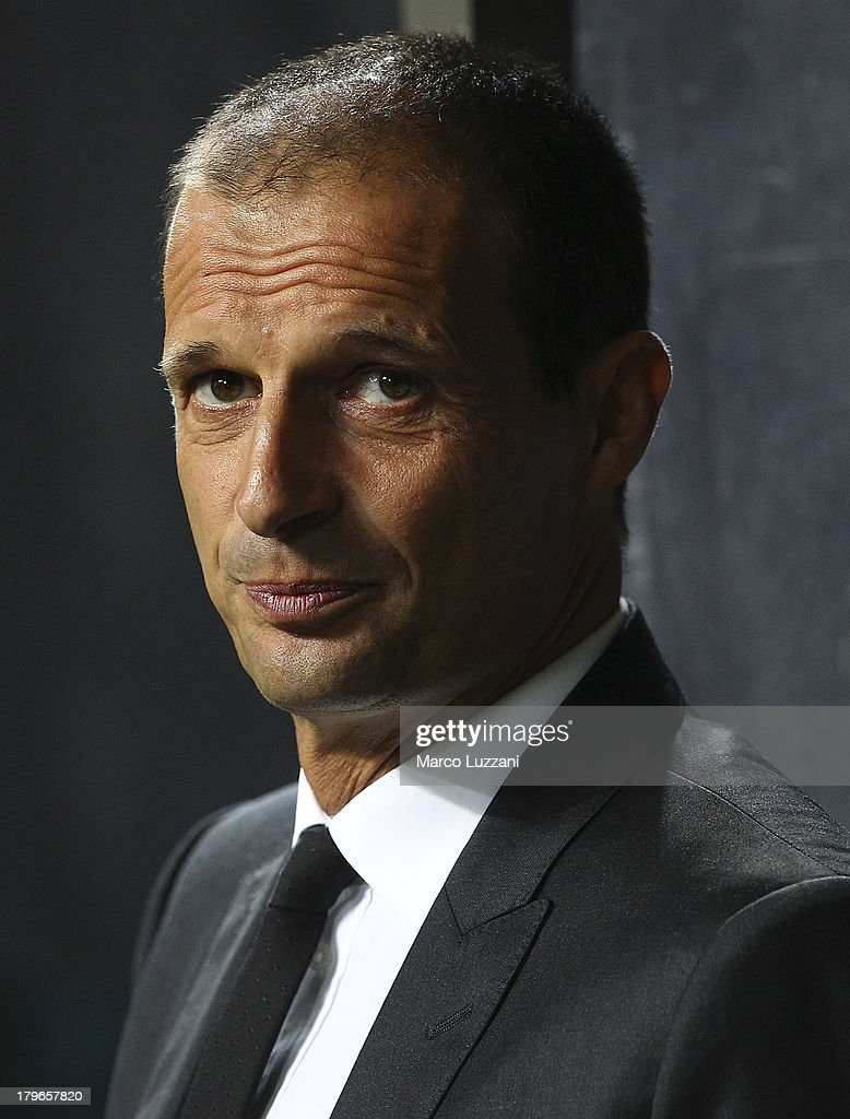 AC Milan manager <a gi-track='captionPersonalityLinkClicked' href=/galleries/search?phrase=Massimiliano+Allegri&family=editorial&specificpeople=3470667 ng-click='$event.stopPropagation()'>Massimiliano Allegri</a> looks on before during the UEFA Champions League Play Off Second leg match between AC Milan and PSV Eindhoven at Stadio Giuseppe Meazza on August 28, 2013 in Milan, Italy.