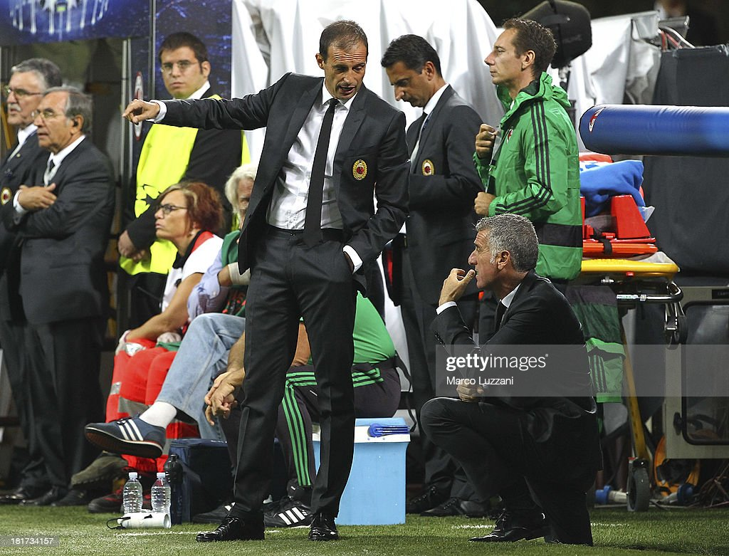 AC Milan manager Massimiliano Allegri (L) speaks the second coach Mauro Tassotti (R) during the UEFA Champions League group H match between AC Milan and Celtic at Stadio Giuseppe Meazza on September 18, 2013 in Milan, Italy.
