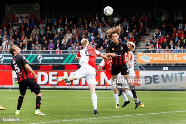 Milan Massop of Excelsior Nicolai Jorgensen of Feyenoord Wout Faes of Excelsior Tonny Vilhena of Feyenoord during the Dutch Eredivisie match between...
