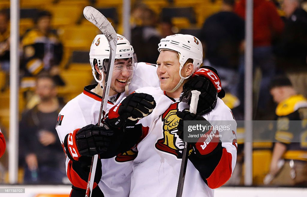 Milan Michalek #9 and Chris Neil #25 of the Ottawa Senators celebrate following their 4-2 win against the Boston Bruins during the game on April 28, 2013 at TD Garden in Boston, Massachusetts.