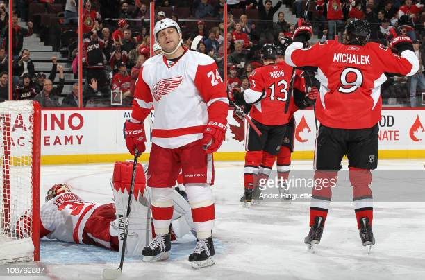 Milan Michalek and Peter Regin of the Ottawa Senators celebrate a firstperiod goal against Ruslan Salei and Jimmy Howard of the Detroit Red Wings at...