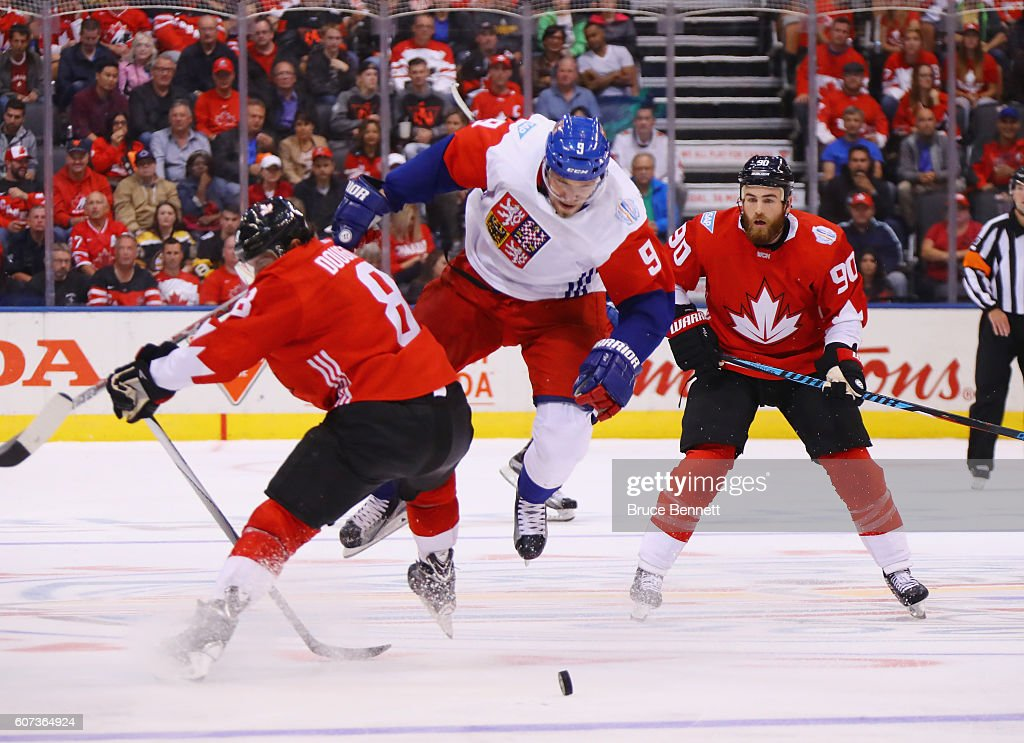 Milan Michalek #9 of Team Czech Republic is trippd up by Drew Doughty #8 of Team Canada during the second period during the World Cup of Hockey tournament at the Air Canada Centre on September 17, 2016 in Toronto, Canada.
