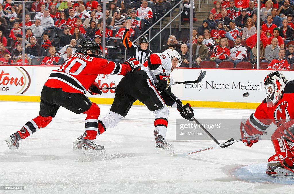 <a gi-track='captionPersonalityLinkClicked' href=/galleries/search?phrase=Milan+Michalek&family=editorial&specificpeople=544987 ng-click='$event.stopPropagation()'>Milan Michalek</a> #9 of the Ottawa Senators attempts a shot against <a gi-track='captionPersonalityLinkClicked' href=/galleries/search?phrase=Martin+Brodeur&family=editorial&specificpeople=201594 ng-click='$event.stopPropagation()'>Martin Brodeur</a> #30 and <a gi-track='captionPersonalityLinkClicked' href=/galleries/search?phrase=Peter+Harrold&family=editorial&specificpeople=579399 ng-click='$event.stopPropagation()'>Peter Harrold</a> #10 of the New Jersey Devils at the Prudential Center on April 12, 2013 in Newark, New Jersey.