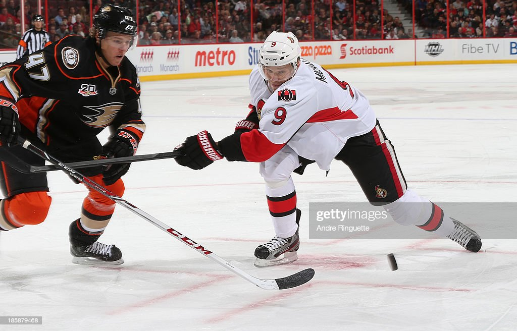 Milan Michalek #9 of the Ottawa Senators battles for a loose puck against Hampus Lindholm #47 of the Anaheim Ducks at Canadian Tire Centre on October 25, 2013 in Ottawa, Ontario, Canada.