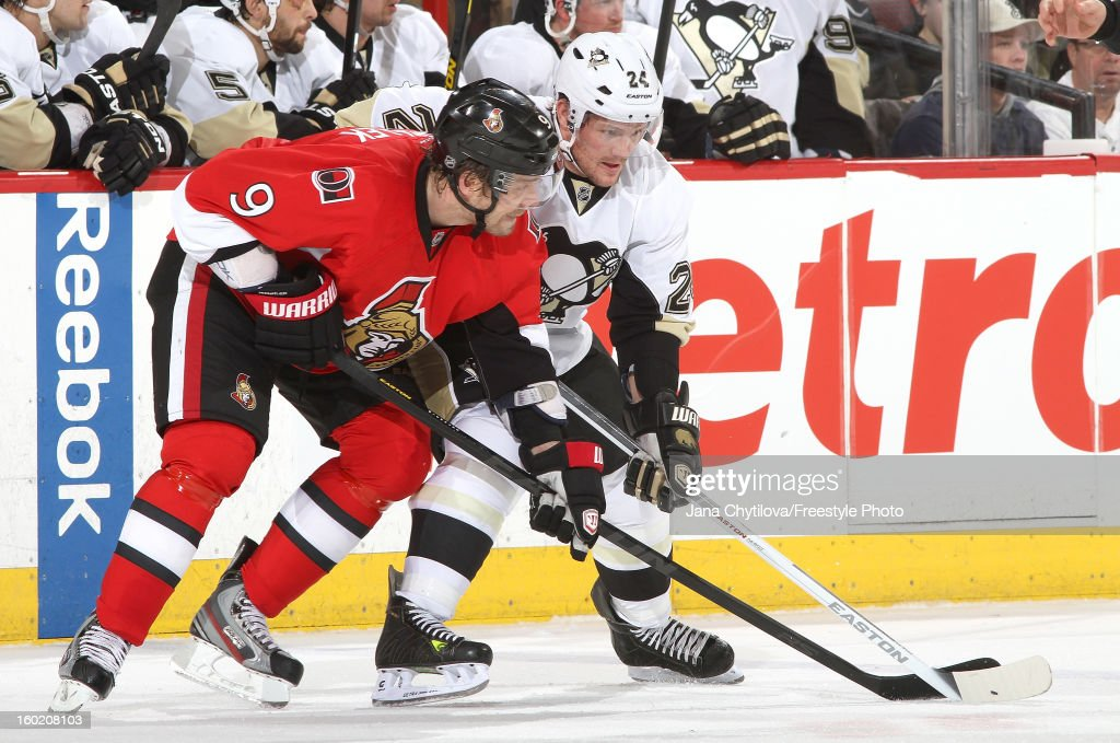 <a gi-track='captionPersonalityLinkClicked' href=/galleries/search?phrase=Milan+Michalek&family=editorial&specificpeople=544987 ng-click='$event.stopPropagation()'>Milan Michalek</a> #9 of the Ottawa Senators battles for position against <a gi-track='captionPersonalityLinkClicked' href=/galleries/search?phrase=Matt+Cooke&family=editorial&specificpeople=592551 ng-click='$event.stopPropagation()'>Matt Cooke</a> #24 of the Pittsburgh Penguins after a face-off during an NHL game at Scotiabank Place on January 27, 2013 in Ottawa, Ontario, Canada.