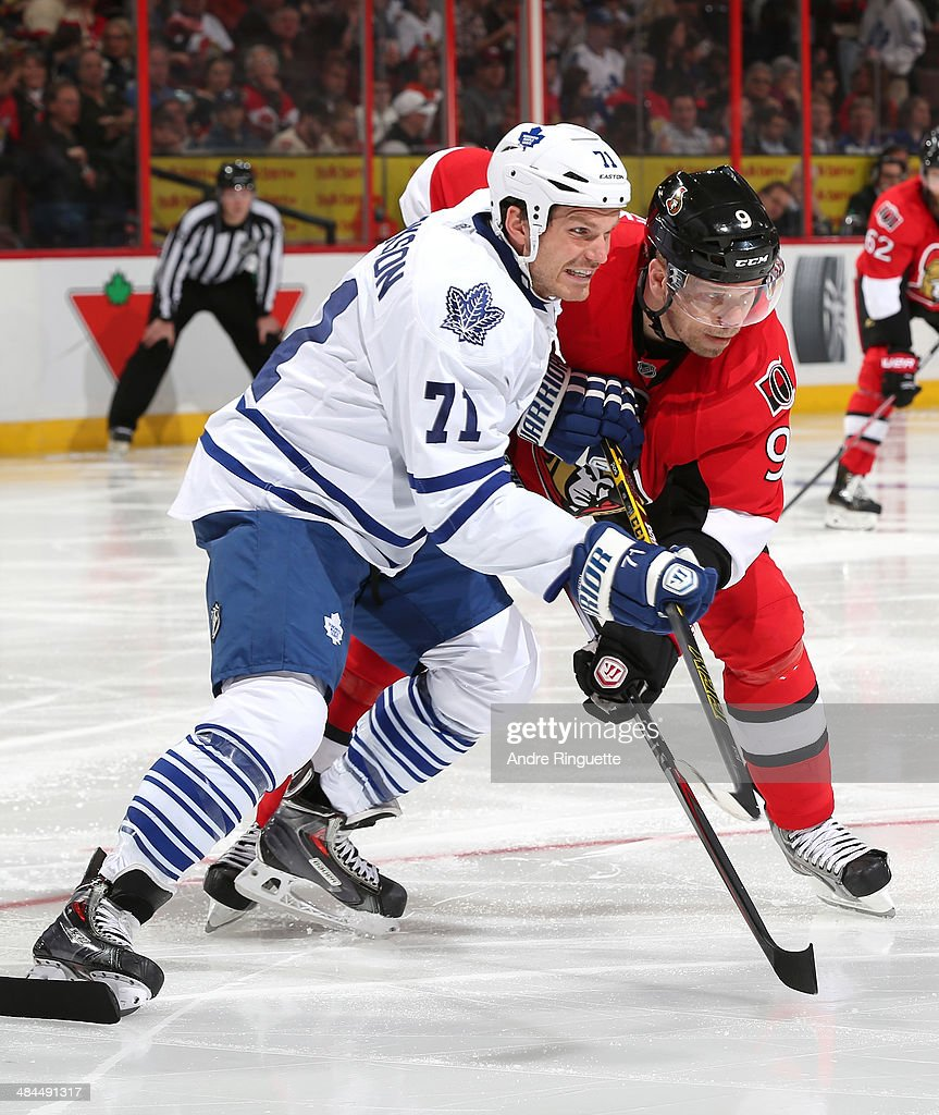 <a gi-track='captionPersonalityLinkClicked' href=/galleries/search?phrase=Milan+Michalek&family=editorial&specificpeople=544987 ng-click='$event.stopPropagation()'>Milan Michalek</a> #9 of the Ottawa Senators battles for position with David Clarkson #71 of the Toronto Maple Leafs at Canadian Tire Centre on April 12, 2014 in Ottawa, Ontario, Canada.