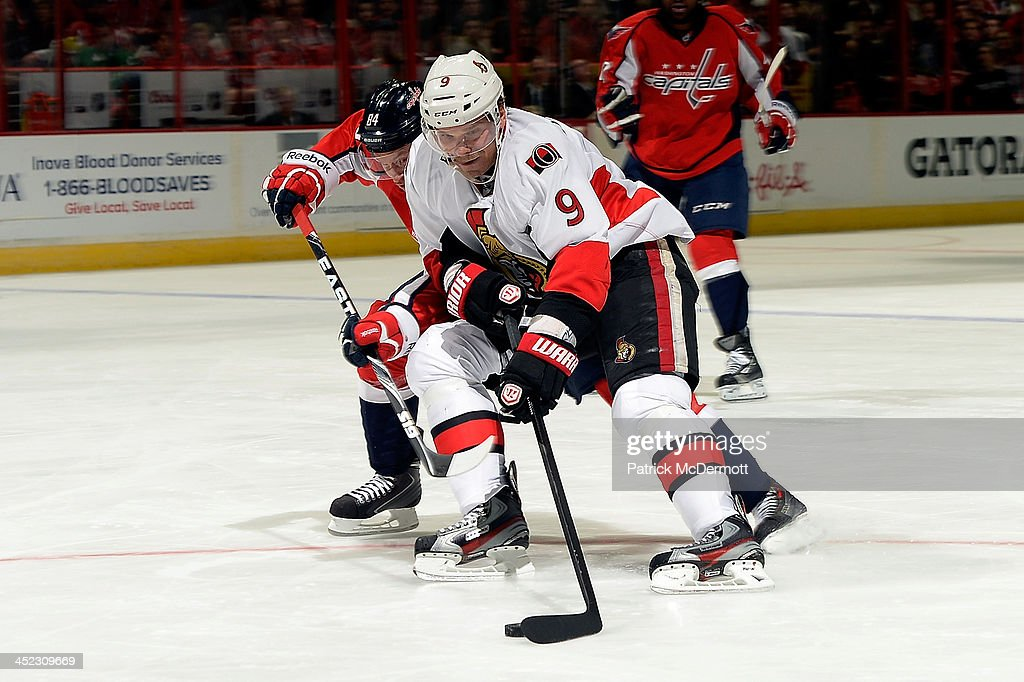 <a gi-track='captionPersonalityLinkClicked' href=/galleries/search?phrase=Milan+Michalek&family=editorial&specificpeople=544987 ng-click='$event.stopPropagation()'>Milan Michalek</a> #9 of the Ottawa Senators battles for the puck against <a gi-track='captionPersonalityLinkClicked' href=/galleries/search?phrase=Mikhail+Grabovski&family=editorial&specificpeople=2560547 ng-click='$event.stopPropagation()'>Mikhail Grabovski</a> #84 of the Washington Capitals in the third period during an NHL game at Verizon Center on November 27, 2013 in Washington, DC.