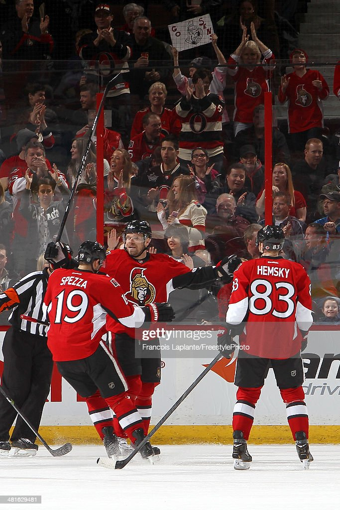 <a gi-track='captionPersonalityLinkClicked' href=/galleries/search?phrase=Milan+Michalek&family=editorial&specificpeople=544987 ng-click='$event.stopPropagation()'>Milan Michalek</a> #9 of the Ottawa Senators celebrates his first period goal with <a gi-track='captionPersonalityLinkClicked' href=/galleries/search?phrase=Jason+Spezza&family=editorial&specificpeople=202023 ng-click='$event.stopPropagation()'>Jason Spezza</a> #19 and <a gi-track='captionPersonalityLinkClicked' href=/galleries/search?phrase=Ales+Hemsky&family=editorial&specificpeople=202828 ng-click='$event.stopPropagation()'>Ales Hemsky</a> #83 against the Calgary Flames during an NHL game at Canadian Tire Centre on March 30, 2014 in Ottawa, Ontario, Canada.