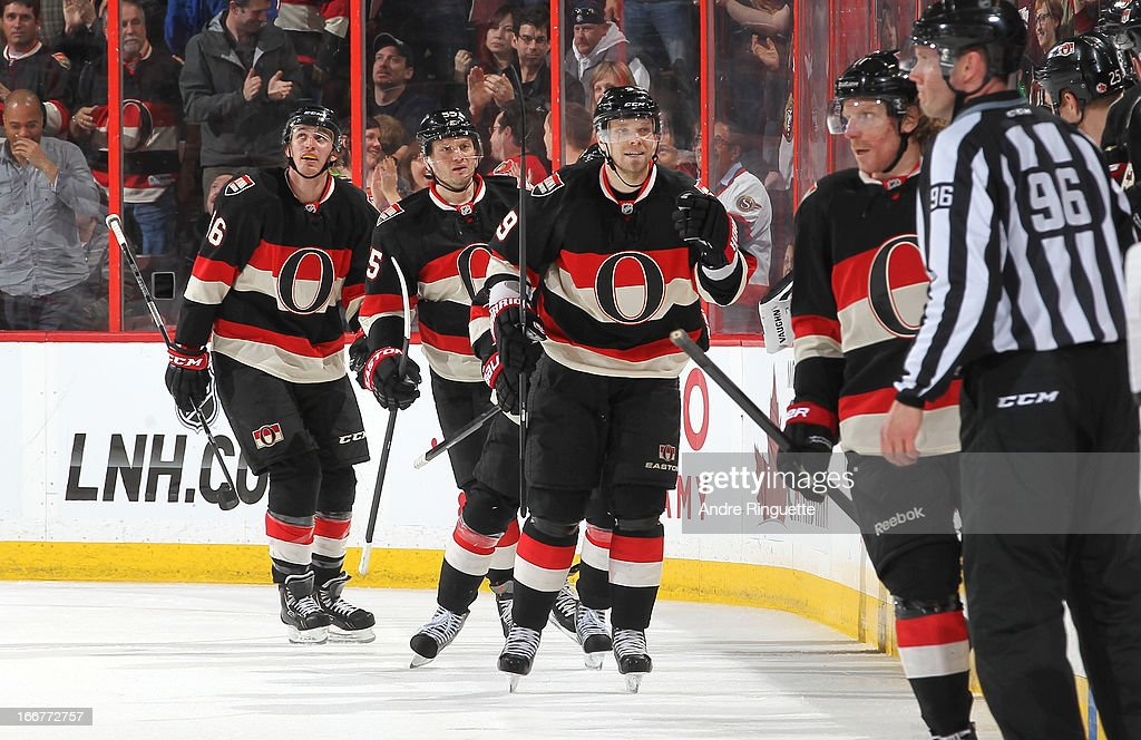 Milan Michalek #9 of the Ottawa Senators celebrates his second period goal against the Carolina Hurricanes with teammates Patrick Wiercioch #46 and Sergei Gonchar #55 on April 16, 2013 at Scotiabank Place in Ottawa, Ontario, Canada.