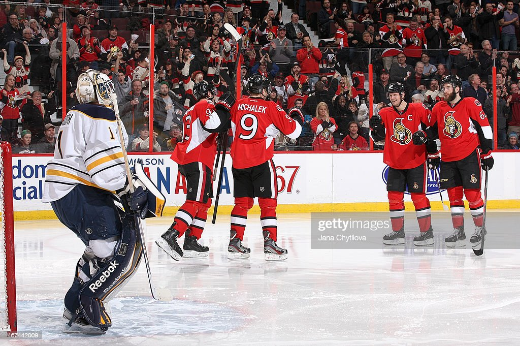 <a gi-track='captionPersonalityLinkClicked' href=/galleries/search?phrase=Milan+Michalek&family=editorial&specificpeople=544987 ng-click='$event.stopPropagation()'>Milan Michalek</a> #9 of the Ottawa Senators celebrates his third period goal against the Buffalo Sabres with team mates <a gi-track='captionPersonalityLinkClicked' href=/galleries/search?phrase=Mika+Zibanejad&family=editorial&specificpeople=7832310 ng-click='$event.stopPropagation()'>Mika Zibanejad</a> #93, <a gi-track='captionPersonalityLinkClicked' href=/galleries/search?phrase=Jason+Spezza&family=editorial&specificpeople=202023 ng-click='$event.stopPropagation()'>Jason Spezza</a> #19 and <a gi-track='captionPersonalityLinkClicked' href=/galleries/search?phrase=Eric+Gryba&family=editorial&specificpeople=570539 ng-click='$event.stopPropagation()'>Eric Gryba</a> #62 as <a gi-track='captionPersonalityLinkClicked' href=/galleries/search?phrase=Jhonas+Enroth&family=editorial&specificpeople=570456 ng-click='$event.stopPropagation()'>Jhonas Enroth</a> #1 of the Buffalo Sabres looks on during an NHL game at Canadian Tire Centre on February 6, 2014 in Ottawa, Ontario, Canada.