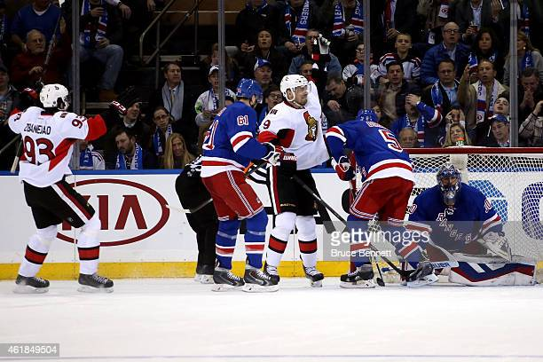 Milan Michalek of the Ottawa Senators celebrates scoring a goal in the second period against Henrik Lundqvist of the New York Rangers during their...