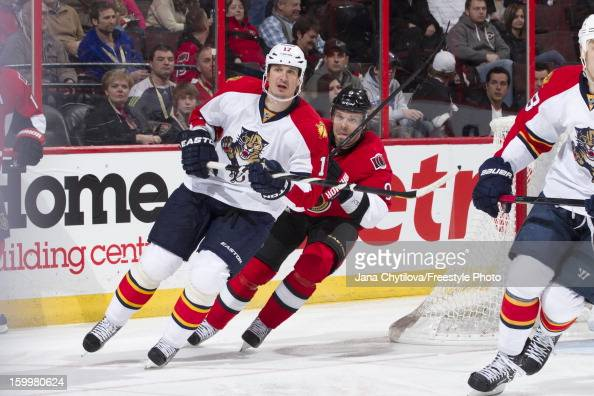 Milan Michalek of the Ottawa Senators chase former team mate Filip Kuba of the Florida Panthers during an NHL game at Scotiabank Place on January 21...