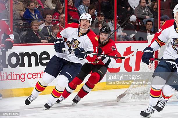 Milan Michalek of the Ottawa Senators chase former team mate Filip Kuba of the Florida Panthers during an NHL game at Scotiabank Place on January 21...
