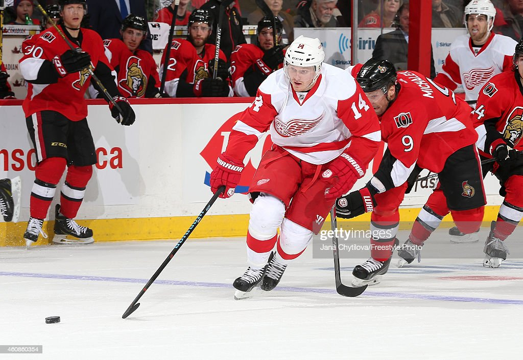 Milan Michalek of the Ottawa Senators chases Gustav Nyquist of the Detroit Red Wings back into their defensive zone in the second period during an...