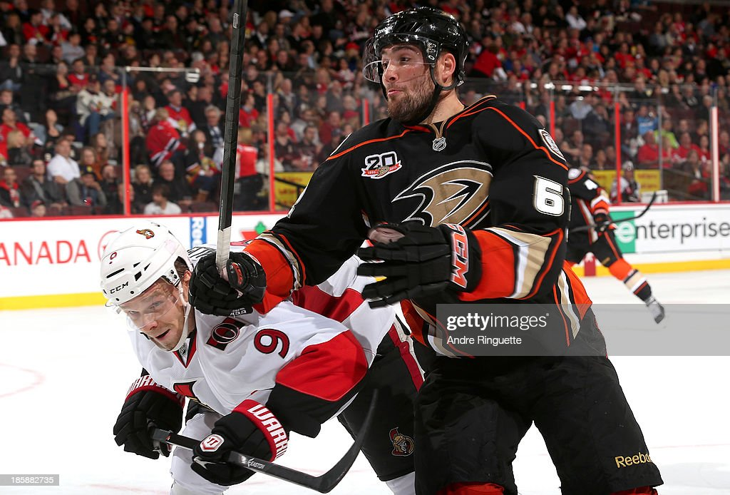 <a gi-track='captionPersonalityLinkClicked' href=/galleries/search?phrase=Milan+Michalek&family=editorial&specificpeople=544987 ng-click='$event.stopPropagation()'>Milan Michalek</a> #9 of the Ottawa Senators collides with <a gi-track='captionPersonalityLinkClicked' href=/galleries/search?phrase=Patrick+Maroon&family=editorial&specificpeople=4589240 ng-click='$event.stopPropagation()'>Patrick Maroon</a> #62 of the Anaheim Ducks close to the boards at Canadian Tire Centre on October 25, 2013 in Ottawa, Ontario, Canada.