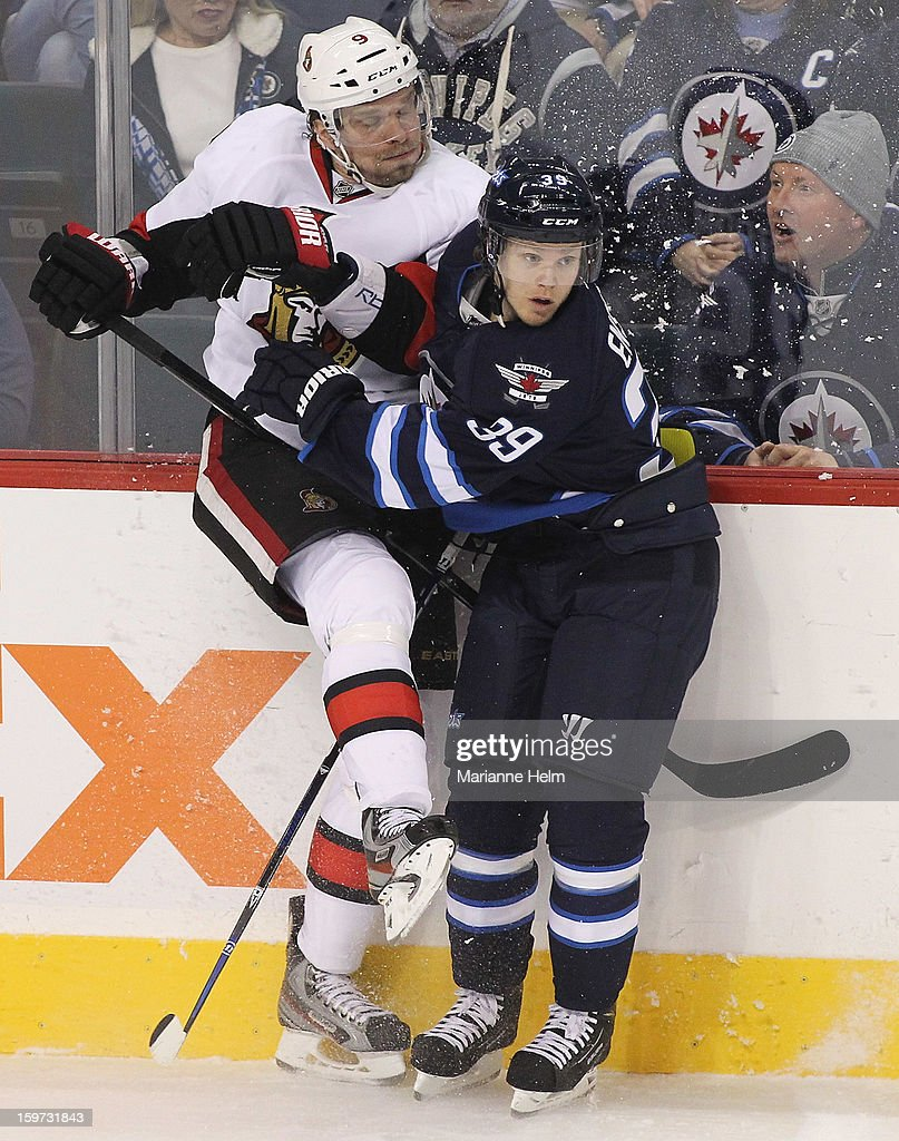 <a gi-track='captionPersonalityLinkClicked' href=/galleries/search?phrase=Milan+Michalek&family=editorial&specificpeople=544987 ng-click='$event.stopPropagation()'>Milan Michalek</a> #9 of the Ottawa Senators collides with Tobias Enstrom #39 of the Winnipeg Jets during third period action on January 19, 2013 at the MTS Centre in Winnipeg, Manitoba, Canada.