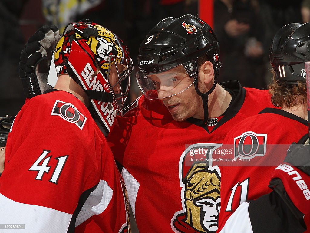 Milan Michalek #9 of the Ottawa Senators congratulates teammate Craig Anderson #41 following their win against the Buffalo Sabres during an NHL game at Scotiabank Place on February 5, 2013 in Ottawa, Ontario, Canada.