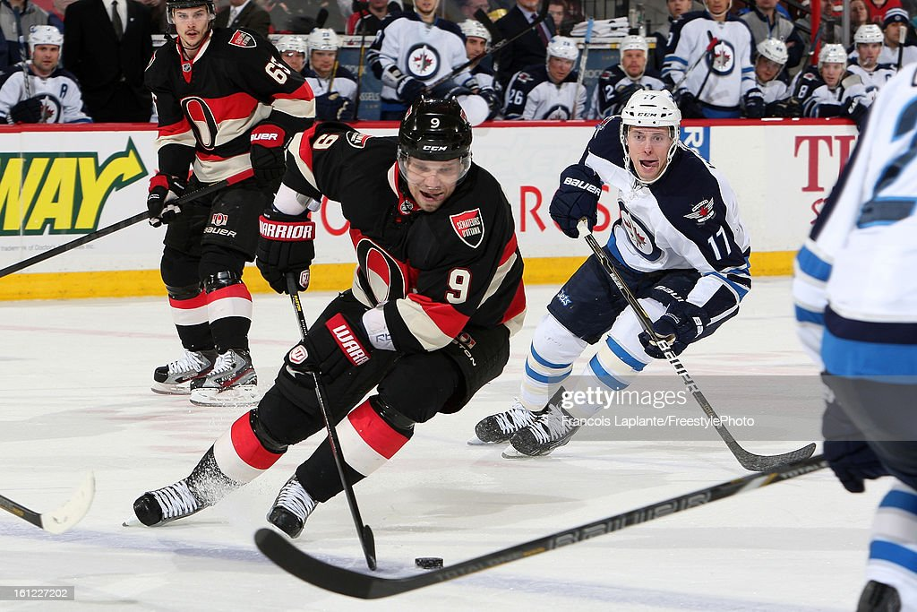 <a gi-track='captionPersonalityLinkClicked' href=/galleries/search?phrase=Milan+Michalek&family=editorial&specificpeople=544987 ng-click='$event.stopPropagation()'>Milan Michalek</a> #9 of the Ottawa Senators controls the puck against James Wright #17 of the Winnipeg Jets during an NHL game at Scotiabank Place on February 9, 2013 in Ottawa, Ontario, Canada.