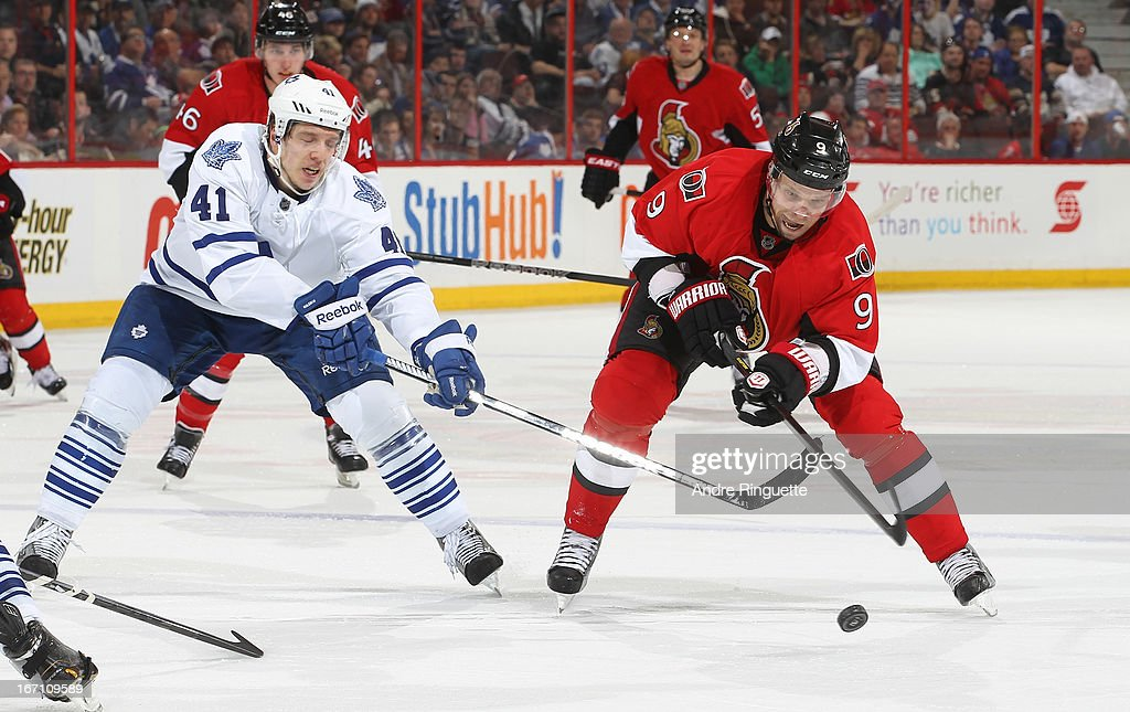 <a gi-track='captionPersonalityLinkClicked' href=/galleries/search?phrase=Milan+Michalek&family=editorial&specificpeople=544987 ng-click='$event.stopPropagation()'>Milan Michalek</a> #9 of the Ottawa Senators controls the puck as <a gi-track='captionPersonalityLinkClicked' href=/galleries/search?phrase=Nikolai+Kulemin&family=editorial&specificpeople=537949 ng-click='$event.stopPropagation()'>Nikolai Kulemin</a> #41 of the Toronto Maple Leafs reaches with how stick to defend against on April 20, 2013 at Scotiabank Place in Ottawa, Ontario, Canada.