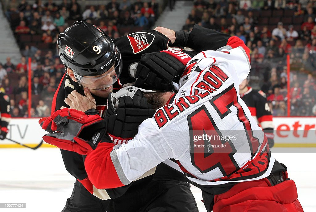 <a gi-track='captionPersonalityLinkClicked' href=/galleries/search?phrase=Milan+Michalek&family=editorial&specificpeople=544987 ng-click='$event.stopPropagation()'>Milan Michalek</a> #9 of the Ottawa Senators fights against <a gi-track='captionPersonalityLinkClicked' href=/galleries/search?phrase=Marc-Andre+Bergeron&family=editorial&specificpeople=213539 ng-click='$event.stopPropagation()'>Marc-Andre Bergeron</a> #47 of the Carolina Hurricanes on April 16, 2013 at Scotiabank Place in Ottawa, Ontario, Canada.