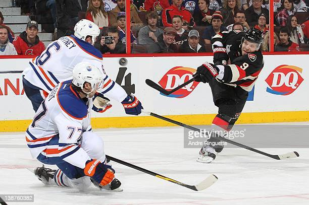 Milan Michalek of the Ottawa Senators fires a slap shot against Ryan Whitney and Tom Gilbert of the Edmonton Oilers at Scotiabank Place on February...
