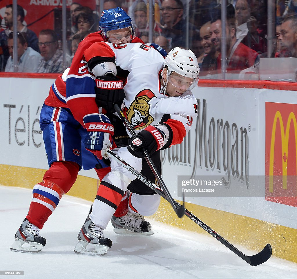 <a gi-track='captionPersonalityLinkClicked' href=/galleries/search?phrase=Milan+Michalek&family=editorial&specificpeople=544987 ng-click='$event.stopPropagation()'>Milan Michalek</a> #9 of the Ottawa Senators passes the puck as <a gi-track='captionPersonalityLinkClicked' href=/galleries/search?phrase=Josh+Gorges&family=editorial&specificpeople=550446 ng-click='$event.stopPropagation()'>Josh Gorges</a> #26 chases from behind in Game Five of the Eastern Conference Quarterfinals during the 2013 NHL Stanley Cup Playoffs at the Bell Centre on May 9, 2013 in Montreal, Quebec, Canada.