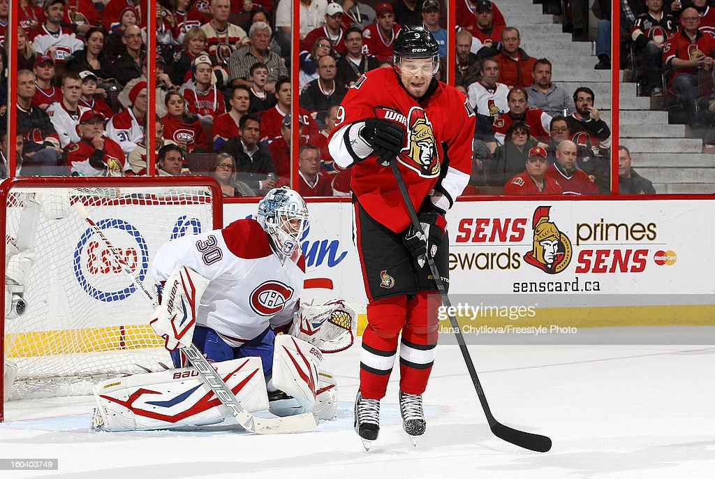 <a gi-track='captionPersonalityLinkClicked' href=/galleries/search?phrase=Milan+Michalek&family=editorial&specificpeople=544987 ng-click='$event.stopPropagation()'>Milan Michalek</a> #9 of the Ottawa Senators reacts to a player taking a shot as <a gi-track='captionPersonalityLinkClicked' href=/galleries/search?phrase=Peter+Budaj&family=editorial&specificpeople=228123 ng-click='$event.stopPropagation()'>Peter Budaj</a> #30 of the Montreal Canadiens follows the play during an NHL game at Scotiabank Place on January 30, 2013 in Ottawa, Ontario, Canada.