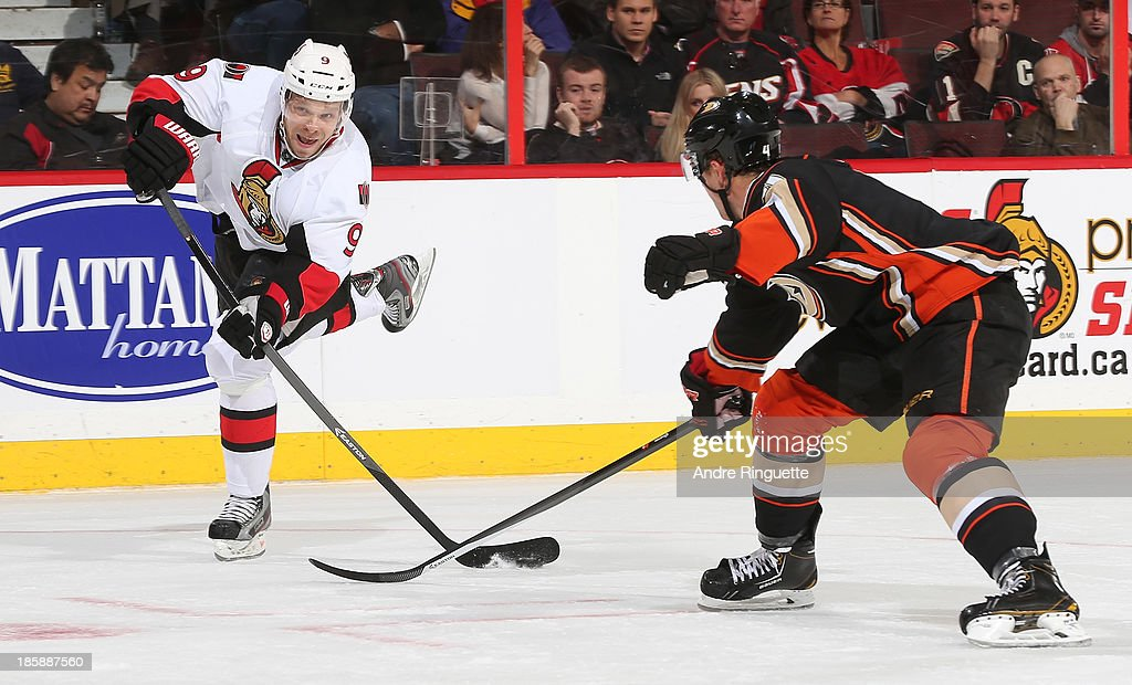 <a gi-track='captionPersonalityLinkClicked' href=/galleries/search?phrase=Milan+Michalek&family=editorial&specificpeople=544987 ng-click='$event.stopPropagation()'>Milan Michalek</a> #9 of the Ottawa Senators shoots the puck against <a gi-track='captionPersonalityLinkClicked' href=/galleries/search?phrase=Cam+Fowler&family=editorial&specificpeople=5484080 ng-click='$event.stopPropagation()'>Cam Fowler</a> #4 of the Anaheim Ducks at Canadian Tire Centre on October 25, 2013 in Ottawa, Ontario, Canada.