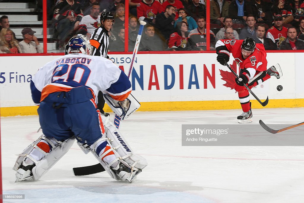 <a gi-track='captionPersonalityLinkClicked' href=/galleries/search?phrase=Milan+Michalek&family=editorial&specificpeople=544987 ng-click='$event.stopPropagation()'>Milan Michalek</a> #9 of the Ottawa Senators shoots the puck against <a gi-track='captionPersonalityLinkClicked' href=/galleries/search?phrase=Evgeni+Nabokov&family=editorial&specificpeople=171380 ng-click='$event.stopPropagation()'>Evgeni Nabokov</a> #20 of the New York Islanders at Canadian Tire Centre on November 1, 2013 in Ottawa, Ontario, Canada.