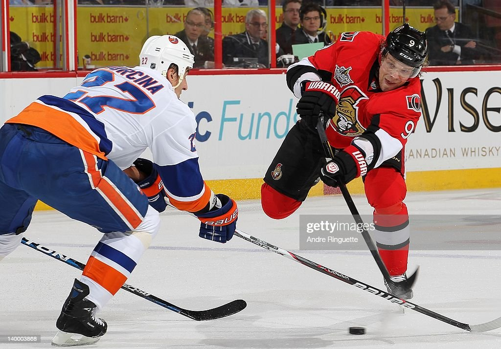 <a gi-track='captionPersonalityLinkClicked' href=/galleries/search?phrase=Milan+Michalek&family=editorial&specificpeople=544987 ng-click='$event.stopPropagation()'>Milan Michalek</a> #9 of the Ottawa Senators shoots the puck against <a gi-track='captionPersonalityLinkClicked' href=/galleries/search?phrase=Milan+Jurcina&family=editorial&specificpeople=243187 ng-click='$event.stopPropagation()'>Milan Jurcina</a> #27 of the New York Islanders at Scotiabank Place on February 26, 2012 in Ottawa, Ontario, Canada.