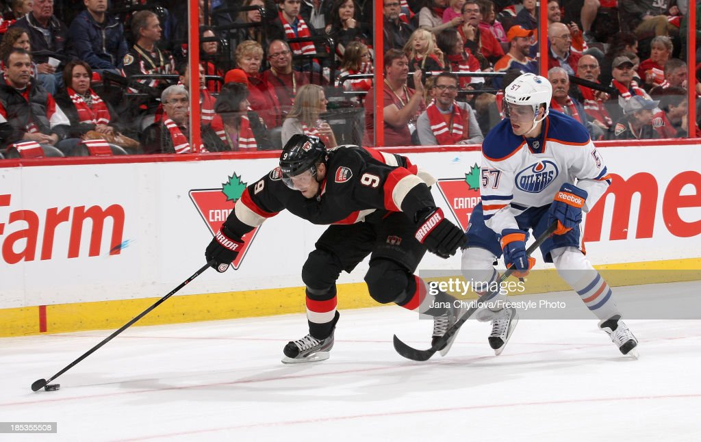 Milan Michalek #9 of the Ottawa Senators skates with the puck as David Perron #57 of the Edmonton Oilers gives chase during an NHL game at Canadian Tire Centre on October 19, 2012 in Ottawa, Ontario, Canada.