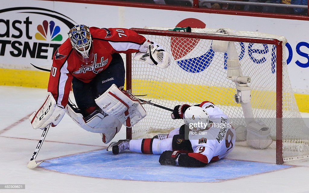 <a gi-track='captionPersonalityLinkClicked' href=/galleries/search?phrase=Milan+Michalek&family=editorial&specificpeople=544987 ng-click='$event.stopPropagation()'>Milan Michalek</a> #9 of the Ottawa Senators slides into goalie <a gi-track='captionPersonalityLinkClicked' href=/galleries/search?phrase=Braden+Holtby&family=editorial&specificpeople=5370964 ng-click='$event.stopPropagation()'>Braden Holtby</a> #70 of the Washington Capitals after being tripped in the third period of the Senators 6-4 win at Verizon Center on November 27, 2013 in Washington, DC.