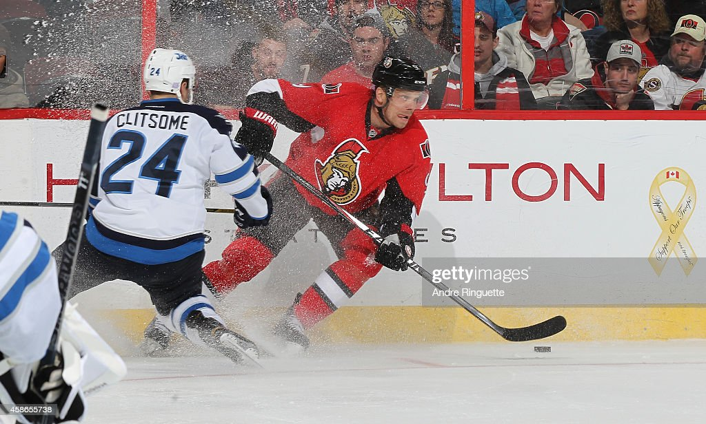 Milan Michalek #9 of the Ottawa Senators stickhandles the puck against Grant Clitsome #24 of the Winnipeg Jets at Canadian Tire Centre on November 8, 2014 in Ottawa, Ontario, Canada.