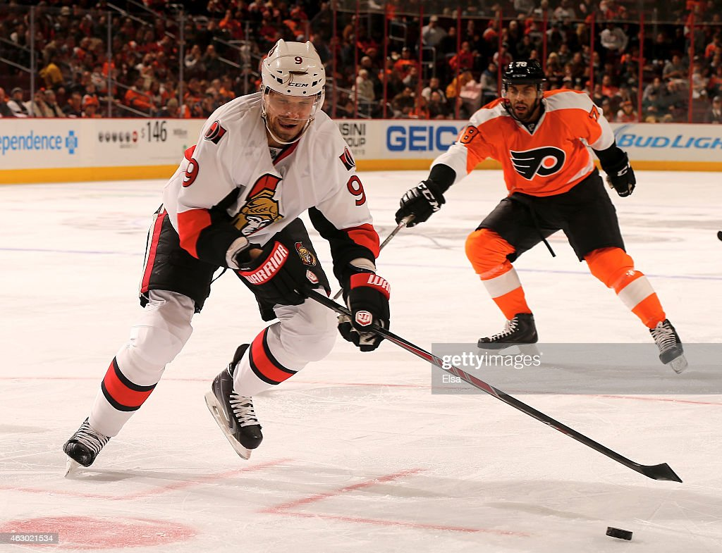 Milan Michalek #9 of the Ottawa Senators takes the puck as Pierre-Edouard Bellemare #78 of the Philadelphia Flyers defends on January 6, 2015 at the Wells Fargo Center in Philadelphia, Pennsylvania.
