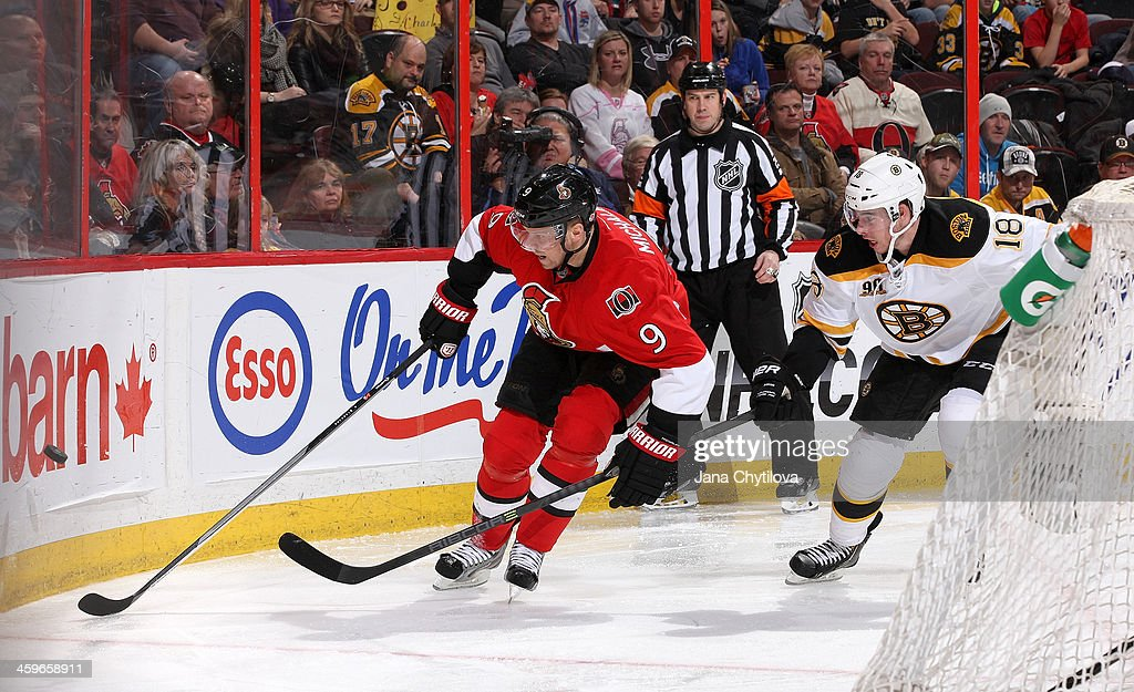 <a gi-track='captionPersonalityLinkClicked' href=/galleries/search?phrase=Milan+Michalek&family=editorial&specificpeople=544987 ng-click='$event.stopPropagation()'>Milan Michalek</a> #9 of the Ottawa Senators uses his body to keep the puck from Reilly Smith #18 of the Boston Bruins as they skate past the net during an NHL game at Canadian Tire Centre on December 28, 2013 in Ottawa, Ontario, Canada.