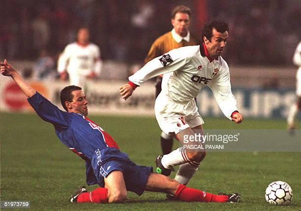 Milan midfielder Dejan Savicevic avoids the tackle of Paris SaintGermain's Paul Le Guen during their Champions League first leg semifinal match 05...
