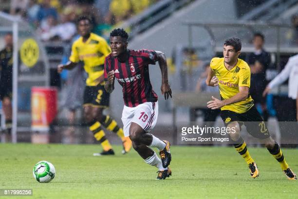 Milan Midfielder Franck Kessie dribbles Borussia Dortmund Midfielder Christian Pulisic during the International Champions Cup 2017 match between AC...