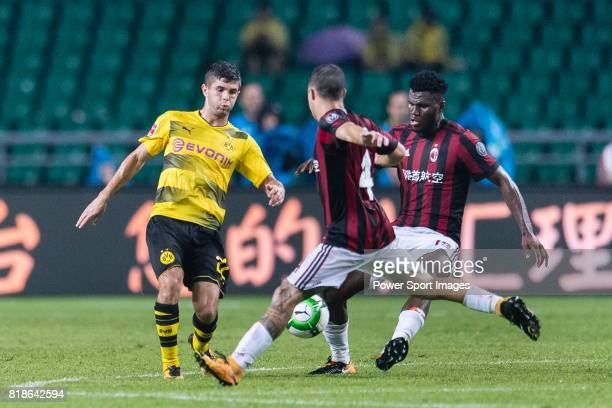 Milan Midfielder Franck Kessie fights for the ball with Borussia Dortmund Midfielder Christian Pulisic during the International Champions Cup 2017...