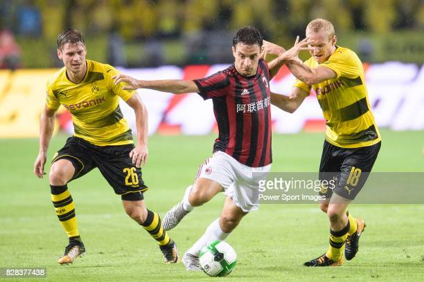 Milan Midfielder Giacomo Bonaventura fights for the ball with Borussia Dortmund Midfielder Sebastian Rode during the International Champions Cup 2017...