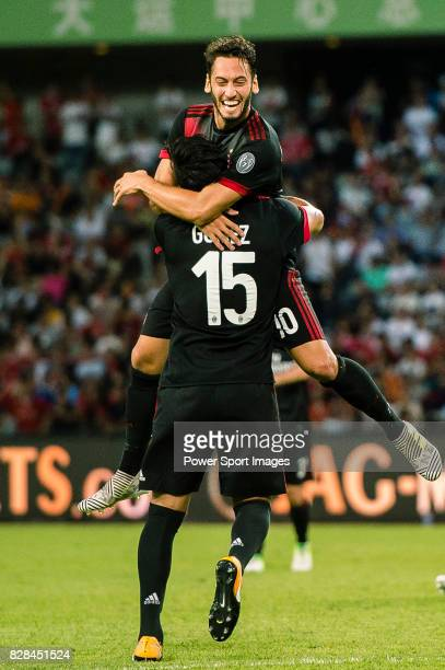 Milan Midfielder Hakan Calhanoglu celebrating his score with AC Milan Defender Gustavo Gomez during the 2017 International Champions Cup China match...