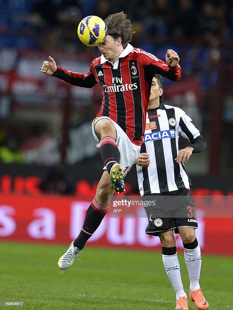 AC Milan MIlan's Riccardo Montolivo heads the ball during the AC Milan vs Udinese Italian Serie A football match on February 3, 2012 at San Siro stadium in Milan.