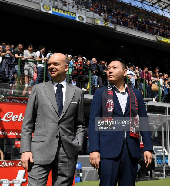 Milan new board member David Han Li and new AC Milan CEO Marco Fassone look on prior to the Serie A match between FC Internazionale and AC Milan at...